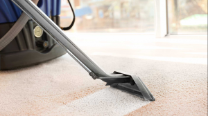 Vacuuming a carpet in North Little Rock Ar